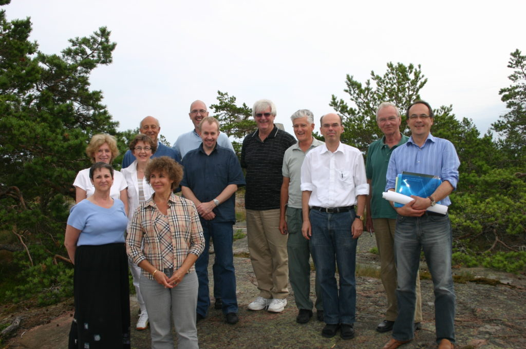 Picture from the album of Hiram Fitzgerald. WAIMH Board members in Ahvenanmaa archipelago, Finland, in July 2007. First row from left: Rachel Schiffman, Tuula Tamminen. Second row from left: Elizabeth Tuters, Pälvi Kaukonen, Mark Tomlinson. Third row from left: Massimo Ammaniti, Neil Boris, Hiram Fitzgerald, Bob Emde, Kai von Klitzing, Peter de Chateau and Antoine Guedeney.